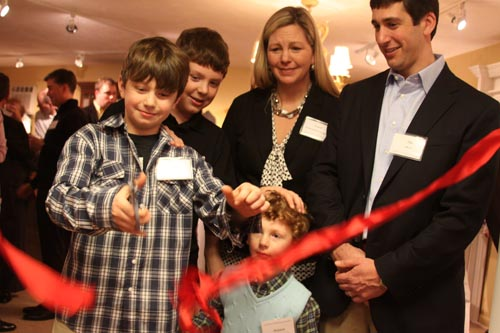 Diana and Jason Frucci with their children cutting the ribbon by Christa J Newman